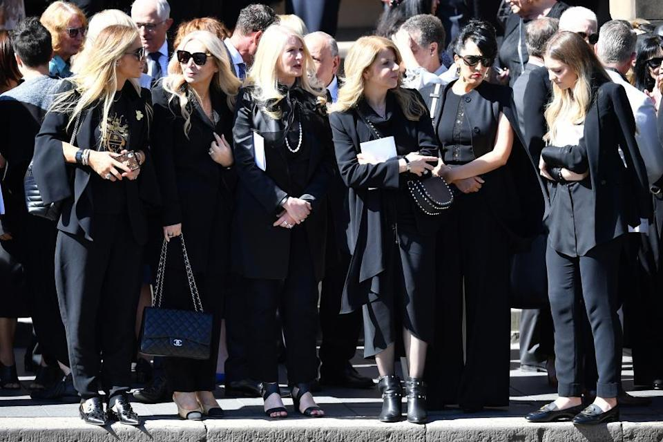 mourners outside the cathedral