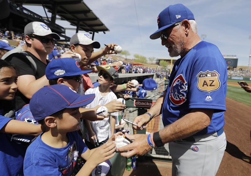 Joe Maddon and the Cubs are favorites once again. (AP)