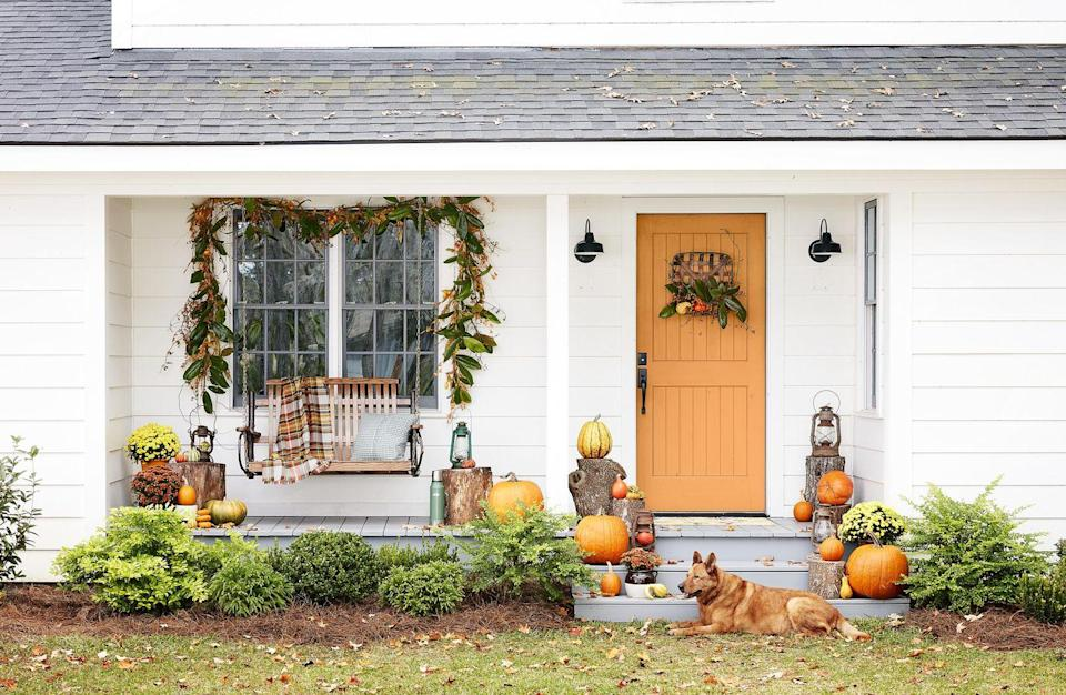 "<p>A few quick DIYs (a tobacco basket filled with mini pumpkins, gourds, and magnolia leaves, a magnolia leaf garland with bittersweet vines nestled throughout) plus a few wood logs and a smattering of pumpkins are all it takes to make your entryway the most inviting on the block. <br><br></p><p><a class=""link rapid-noclick-resp"" href=""https://www.amazon.com/Silvercloud-Trading-Co-Tobacco-Farmhouse/dp/B06Y2BL2MX/ref=sr_1_5?tag=syn-yahoo-20&ascsubtag=%5Bartid%7C10050.g.2063%5Bsrc%7Cyahoo-us"" rel=""nofollow noopener"" target=""_blank"" data-ylk=""slk:SHOP TOBACCO BASKET"">SHOP TOBACCO BASKET</a><br></p>"
