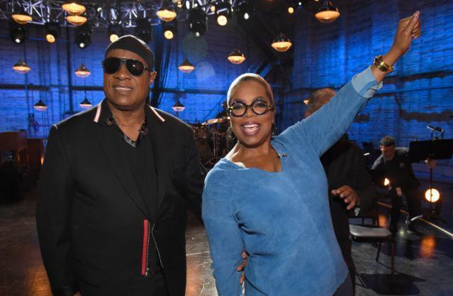 Stevie Wonder and Oprah cheer on callers during the telethon