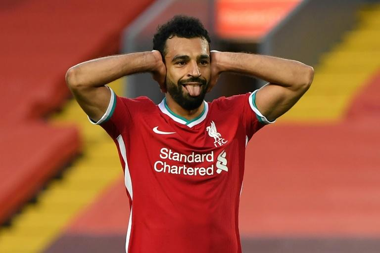 Salah hat-trick saves Liverpool, Arsenal cruise as Premier League returns