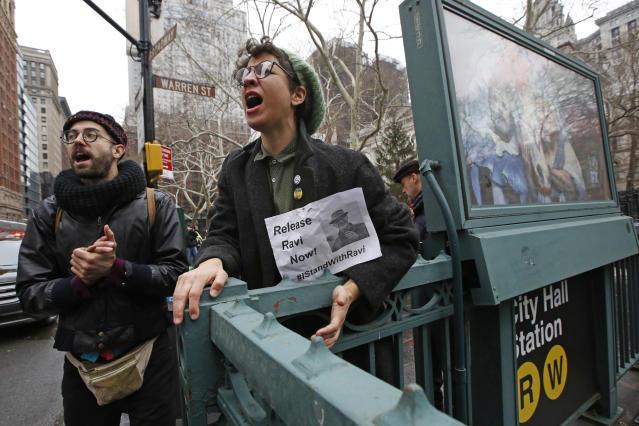 <p>Protesters shout slogans and sing to support anti-deportation protesters arrested near City Hall, Thursday, Jan. 11, 2018, in New York. The protesters said they were supporting the director of Judson Church's New Sanctuary Coalition, who was taken in an ambulance after reporting to the Immigration and Enforcement office in lower Manhattan. (Photo: Kathy Willens/AP) </p>