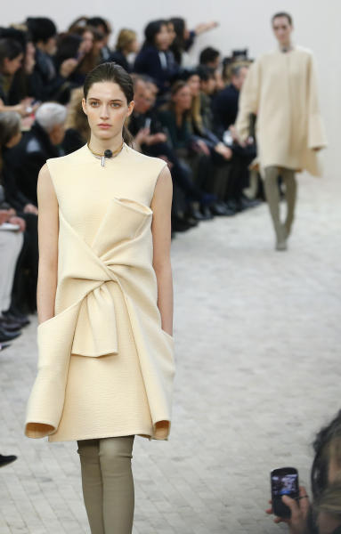 A model presents a creation for Celine's Ready to Wear Fall-Winter 2013-2014 fashion collection, presented Sunday, March 3, 2013 in Paris. (AP Photo/Jacques Brinon)