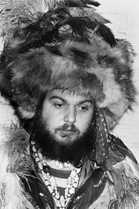 Dr John in signature headdress, feathers, rings and beads (Rex)
