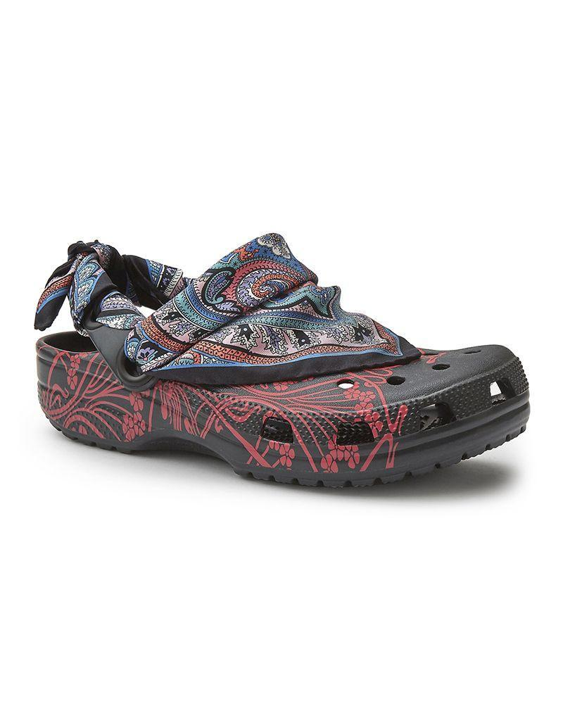 """<p>In Spring of 2020, Crocs unveiled a collaboration with historic British department store Liberty London. The retailer issued a series of clogs and slides, in three different prints, with a silk scarf (the like of which Liberty is famous for) embellishing some of the designs. </p><p><a class=""""link rapid-noclick-resp"""" href=""""https://go.redirectingat.com?id=127X1599956&url=https%3A%2F%2Fwww.libertylondon.com%2F&sref=https%3A%2F%2Fwww.elle.com%2Fuk%2Ffashion%2Ftrends%2Fg36656071%2Fcroc-collaborations%2F"""" rel=""""nofollow noopener"""" target=""""_blank"""" data-ylk=""""slk:SHOP LIBERTY LONDON"""">SHOP LIBERTY LONDON</a></p>"""
