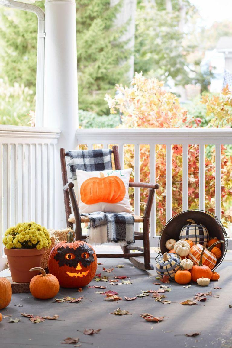 <p>Plaid is the signature pattern of fall, which means you can always incorporate it into your outdoor Halloween display. To make the plaid pumpkins seen here, choose two or three colors and add fine lines between the thick ones. </p>
