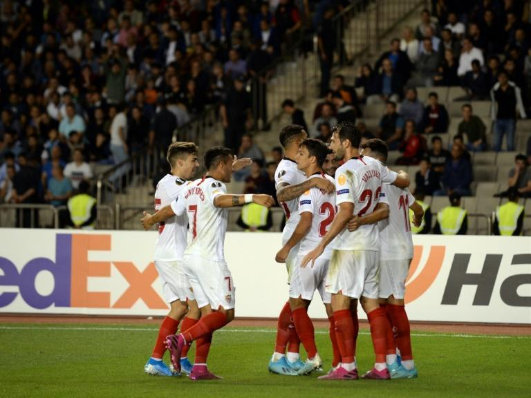 Sevilla warmed up for their weekend clash with Real Madrid with an easy win in Azerbaijan (AFP Photo/Tofik BABAYEV)