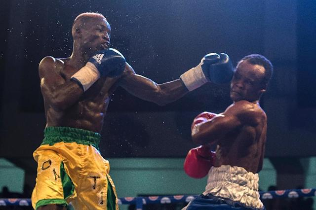 In Ghana, hundreds of young men from are aspiring to be boxing champions (AFP Photo/Cristina Aldehuela)