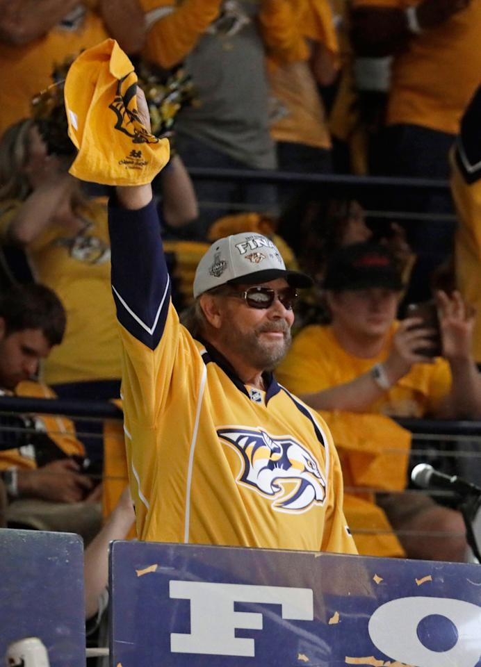 <p>Musician Hank Williams Jr. waves the rally towel before the start of Game 3 of the Stanley Cup Final in Nashville.<br /> (Mark Humphrey/AP) </p>