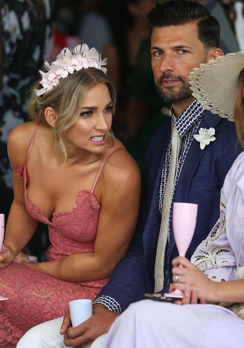 Tim Robards has said he is 'scared' what his groomsmen are planning for his bucks party. He is pictured here with Anna Heinrich at the Caulfield Cup in October 2017. Source: Getty