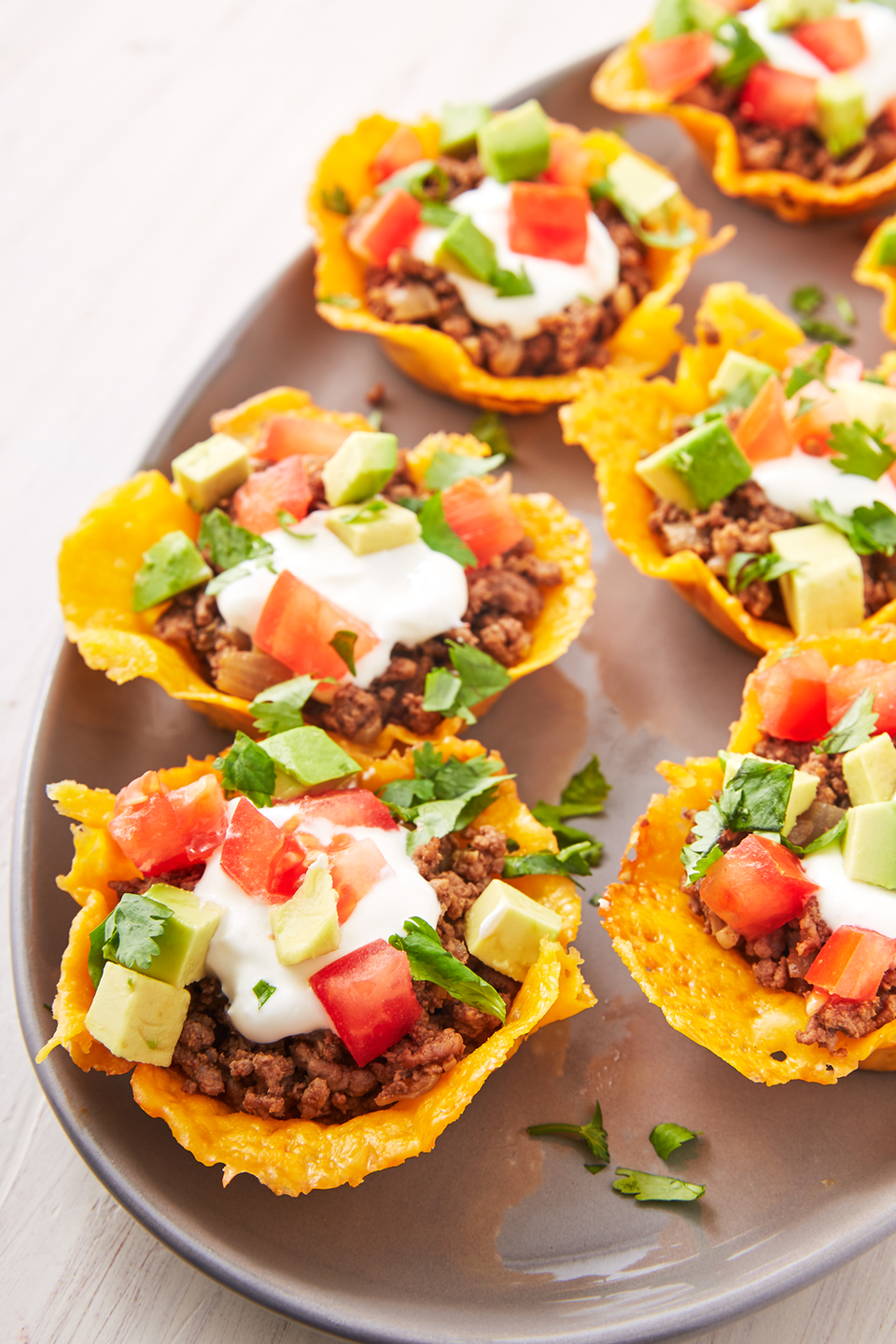 """<p>Just like you can make chips out of cheese, taco shells can also be fashioned out of fried cheese. Let your cheese cool in the muffin shell before stuffing them with keto-friendly ingredients.</p><p><a href=""""https://www.delish.com/cooking/recipe-ideas/a19637783/keto-taco-cups-recipe/"""" rel=""""nofollow noopener"""" target=""""_blank"""" data-ylk=""""slk:Get the recipe from Delish »"""" class=""""link rapid-noclick-resp""""><em>Get the recipe from Delish</em> »</a></p>"""