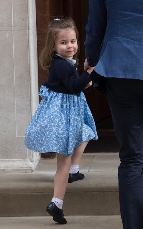 The floral smocked dress worn by Princess Charlotte as she went to meet her new baby brother has sold out online - Credit: Samir Hussein/WireImage
