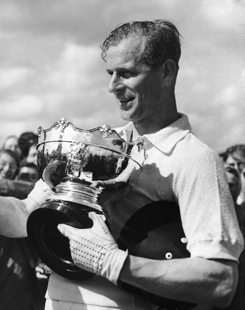 <p>The Duke of Edinburgh in June 1952 with a cup presented to him as captain of the winning team of a polo match at Amberly. </p>