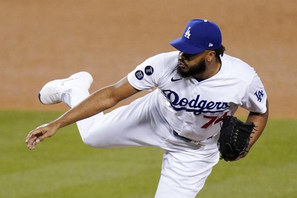 Dodgers relief pitcher Kenley Jansen delivers during the ninth inning of a 6-4 win over the Seattle Mariners.