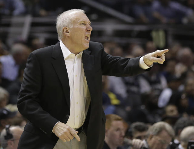 San Antonio Spurs coach Gregg Popovich calls to his players during the first half of an NBA basketball game against the Atlanta Hawks, Monday, Dec. 2, 2013, in San Antonio. (AP Photo/Eric Gay)