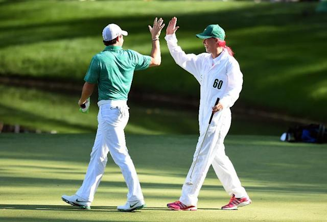 Rory McIlroy of Northern Ireland highfives with his former girlfriend, tennis star Caroline Wozniacki, during the 78th Masters Golf Tournament at Augusta National Golf Club on April 9, 2014 in Augusta, Georgia (AFP Photo/Jim Watson)