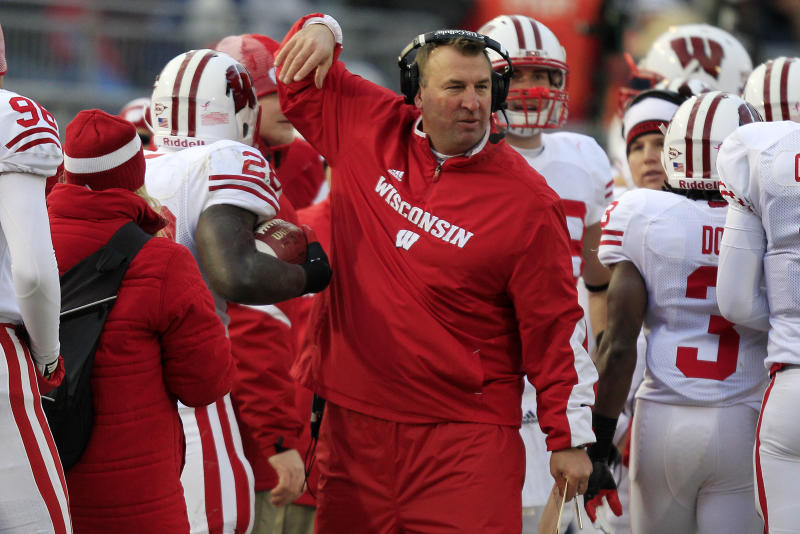 Wisconsin head coach Bret Bielema, center, celebrates with Wisconsin running back Montee Ball (28) after a touchdown run during the first quarter of an NCAA college football game against Penn State in State College, Pa., Saturday, Nov. 24, 2012. (AP Photo/Gene J. Puskar)