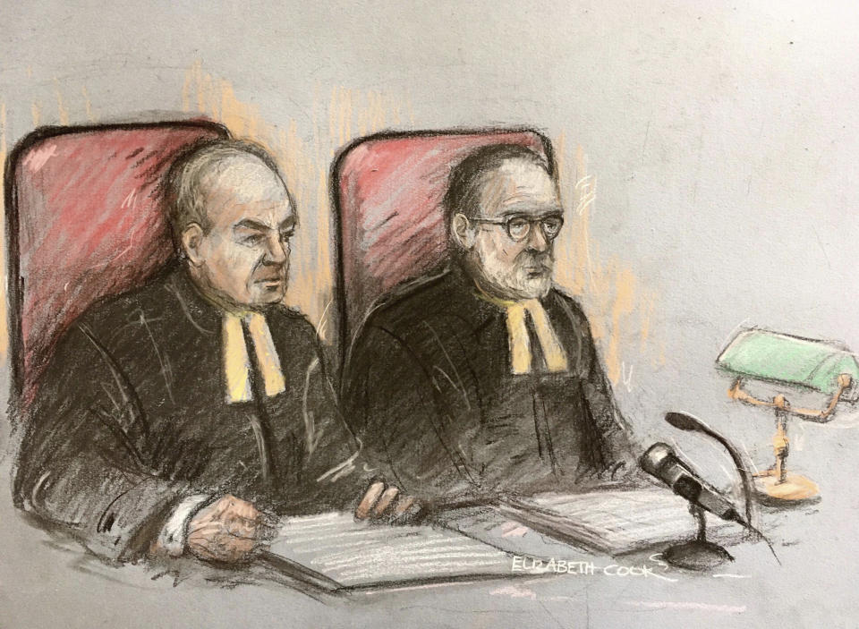 Court artist sketch by Elizabeth Cook, showing Lord Justice Dingemans, left, and Lord Justice Underhill at the Royal Courts of Justice in London, Thursday March 18, 2021, for Johnny Depp's application for permission to appeal against a High Court ruling that he assaulted his ex-wife Amber Heard and put her in fear for her life. (Elizabeth Cook/PA via AP)