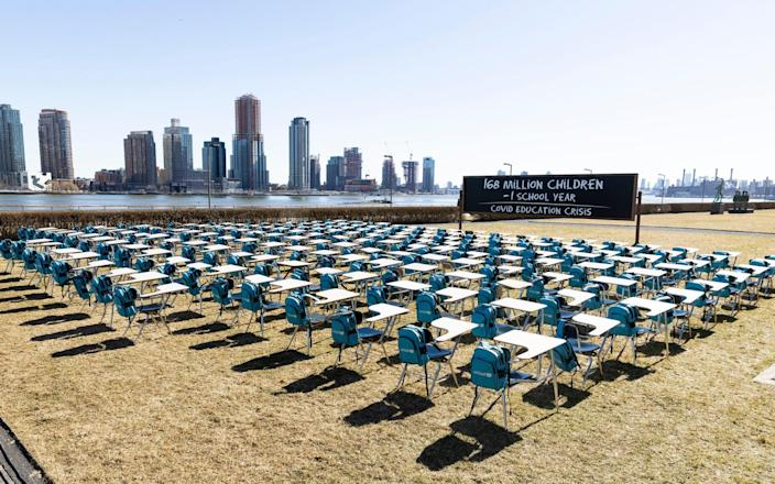 A grid of 168 desks makes up the UNICEF organized 'pandemic classroom' installation on the grounds of United Nations headquarters in New York - JUSTIN LANE/EPA-EFE/Shutterstock