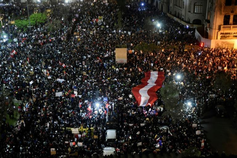 Demonstrators protest in Lima's San Martin square on November 12, 2020