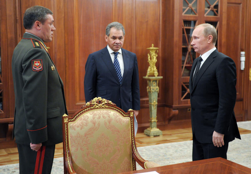 From left: Col. Gen Valery Gerasimov, Defense Minister Sergei Shoigu, and President Vladimir Putin meet in Moscow's Kremlin on Friday, Nov. 9, 2012. On Friday, Putin named Col. Gen. Valery Gerasimov the new chief of the armed forces' General Staff to replace Gen. Nikolai Makarov. He also reshuffled several other top generals. (AP Photo/RIA Novosti, Alexei Druzhinin, Presidential Press Service)