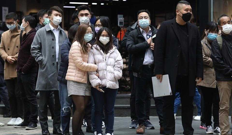 Masked pedestrians in Hong Kong's Central. The city is reeling from a fourth wave of Covid-19 infections. Photo: Xiaomei Chen