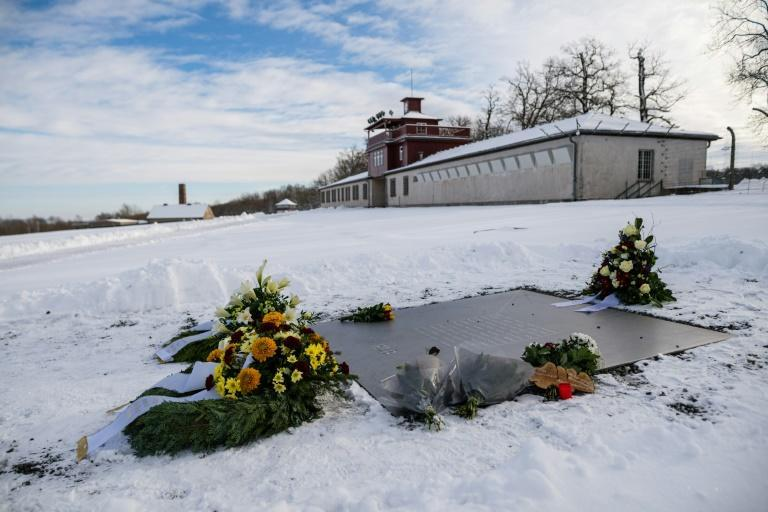 Flowers and wreathes are placed on a commemorative plaque at the memorial site of the former Nazi concentration camp Buchenwald
