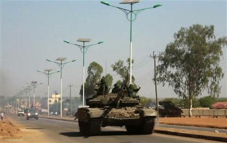 A military tank patrols along one of the main roads in the South Sudanese capital Juba