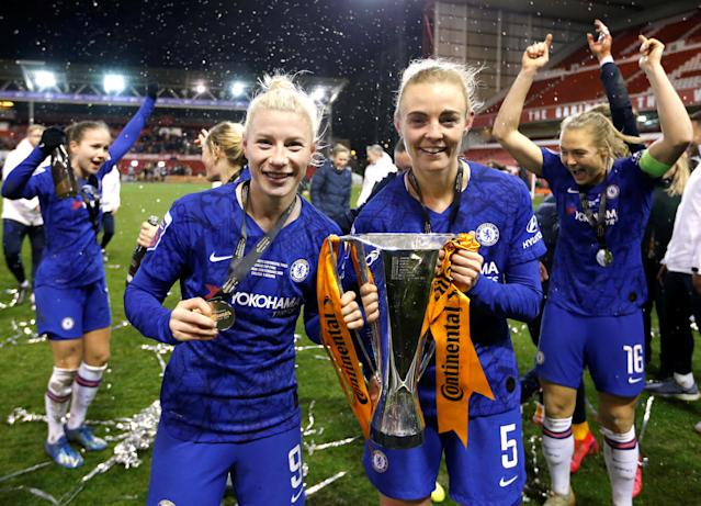 Chelsea's Beth England and Sophie Ingle celebrate with the trophy after winning the FA Women's Continental League Cup Final