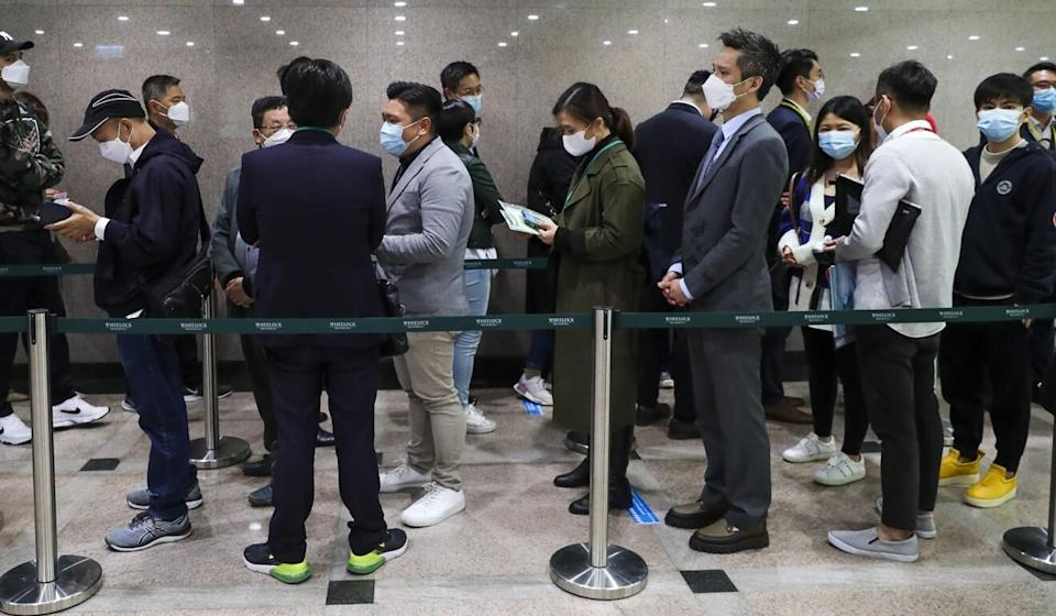 Hongkongers line up at a flat sale by Wheelock Properties at its sales office in The Gateway in Tsim Sha Tsui. Photo: Edmond So
