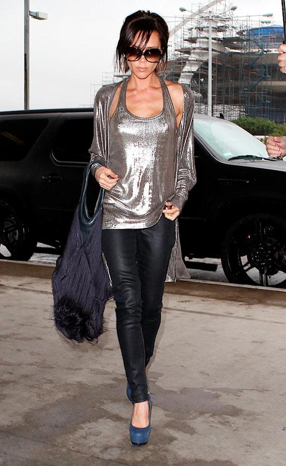 "Shimmering in a silver tank and cardigan, Victoria Beckham put on a brave face while departing LAX airport for London on Monday. Last Thursday thieves stole over $575,000 worth of merchandise from the celeb designer's Spring/Summer 2010 collection. The shipment was hijacked on route to Neiman Marcus in New York. Merino-IONU/<a href=""http://www.x17online.com"" target=""new"">X17 Online</a> - December 7, 2009"