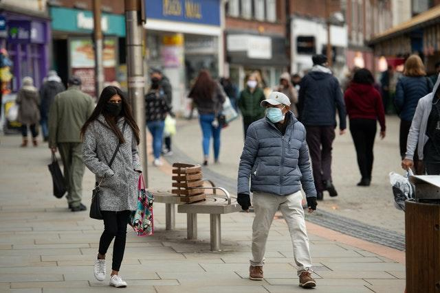 Shoppers wearing protective face masks walk along Market Place, Dudley, in the West Midlands (Jacob King/PA)