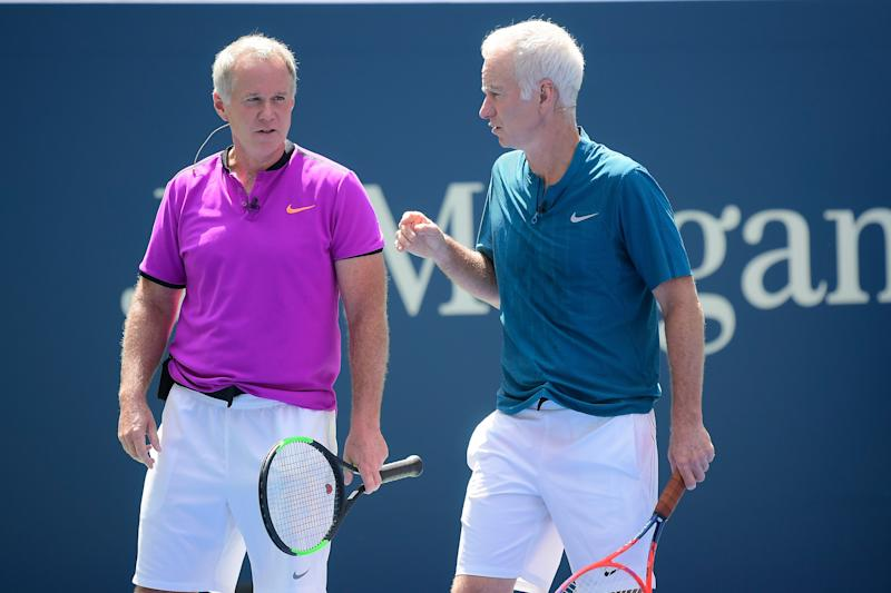 Patrick McEnroe and John McEnroe at a 2018 exhibition match at the USTA Billie Jean King National Tennis Center.