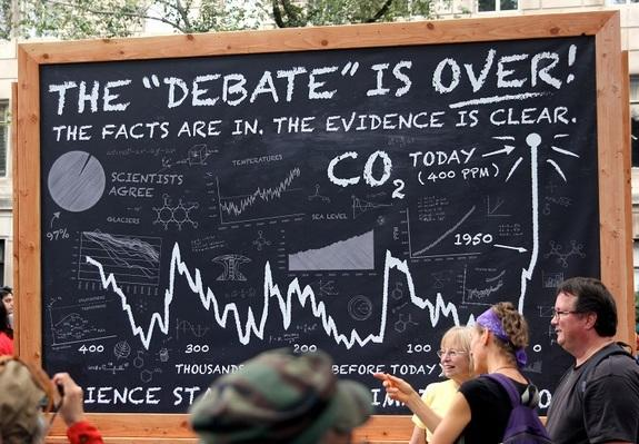 "A group of scientists joined the ""The Debate Is Over"" themed section of the climate change march."