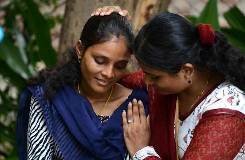 University student Santadevi Meghwal (L) a victim of child marriage, is consoled by Kriti Bharti, founder of Sarathi Trust, as she breaks down during an interview with AFP in Jodhpur (AFP Photo/Money Sharma)