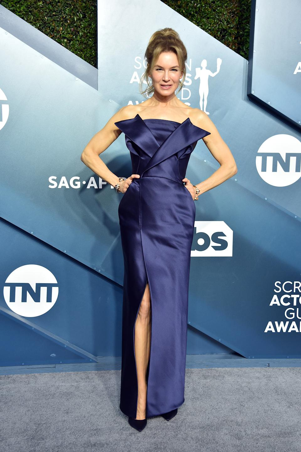 """The """"Judy"""" star went retro with her navy column gown and beehive-inspired hairstyle."""