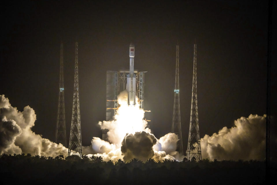 A Long March 7 rocket carrying the Tianzhou-2 spacecraft lifts off from the Wenchang Space Launch Center in Wenchang in southern China's Hainan Province, Saturday, May 29, 2021. A rocket carrying supplies for China's new space station blasted off Saturday from an island in the South China Sea. (Chinatopix via AP)