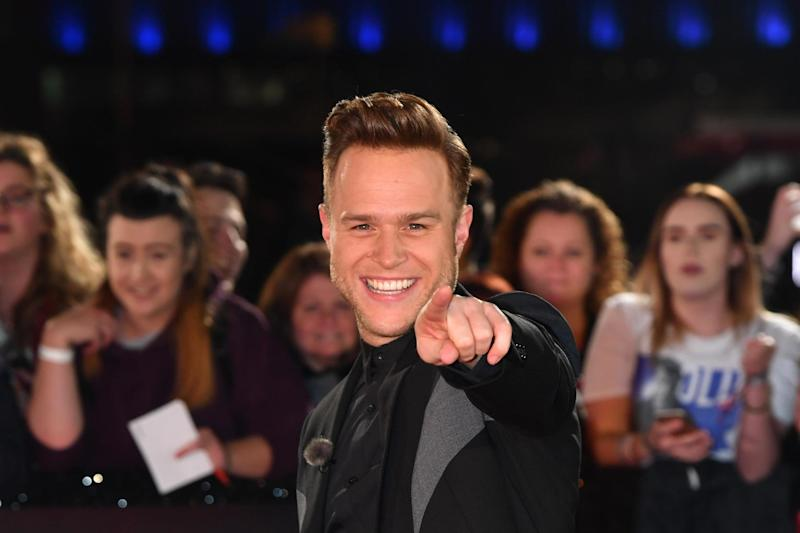 Bad timing: Olly Murs had been caught midway through a fitting: Getty Images