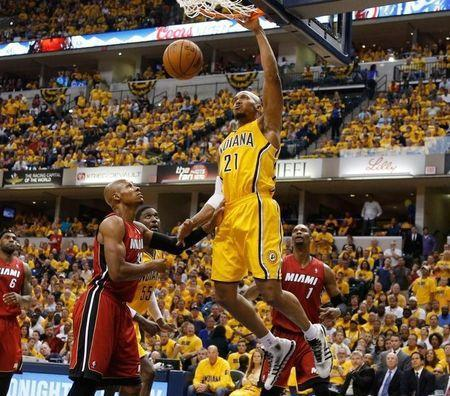 May 18, 2014; Indianapolis, IN, USA; Indiana Pacers forward David West (21) dunks against Miami Heat guard Ray Allen (34) and center Chris Bosh (1) in game one of the Eastern Conference Finals of the 2014 NBA Playoffs at Bankers Life Fieldhouse. Indiana defeats Miami 107-96. Brian Spurlock-USA TODAY Sports