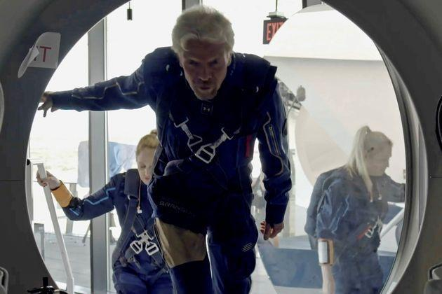 Richard Branson and Virgin Galactic crew members enter the company's passenger rocket plane, the VSS Unity, in a still image from undated handout video taken at Spaceport America near Truth or Consequences, New Mexico, U.S.     Virgin Galactic/Handout via REUTERS.  NO RESALES. NO ARCHIVES. THIS IMAGE HAS BEEN SUPPLIED BY A THIRD PARTY.     TPX IMAGES OF THE DAY (Photo: VIRGIN GALACTIC via via REUTERS)