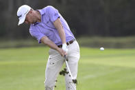 Justin Thomas hits from the 14th fairway during the first round of the PNC Championship golf tournament, Saturday, Dec. 19, 2020, in Orlando, Fla. (AP Photo/Phelan M. Ebenhack)