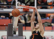 Oregon State forward Tres Tinkle (3) dunks during the first half of an NCAA college basketball game against Washington State in Pullman, Wash., Saturday, March 9, 2019. (AP Photo/Young Kwak)