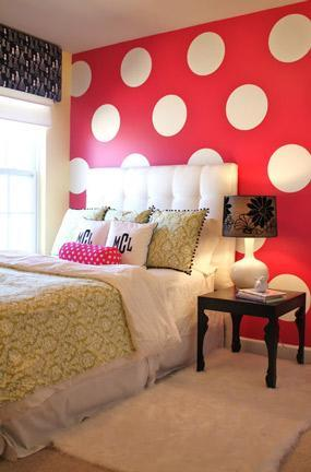 """<div class=""""caption-credit""""> Photo by: Emily A. Clark</div><div class=""""caption-title"""">Oversized Polka Dots</div>As with many trends such as sunglasses and handbags, polka dots often are better when they're bigger! This hot-pink accent wall of oversized polka dots is a total knockout. <br> <b><i><a href=""""http://www.babble.com/toddler-times/2012/08/17/20-awesome-home-decor-ideas-using-chalkboard-paint/?cmp=ELP bbl lp YahooShine Main  011413  seeingspots10awesomepolkadotwalls famE   """" rel=""""nofollow noopener"""" target=""""_blank"""" data-ylk=""""slk:Related: 20 genius ways to decorate with chalkboard paint"""" class=""""link rapid-noclick-resp"""">Related: 20 genius ways to decorate with chalkboard paint</a></i></b>"""