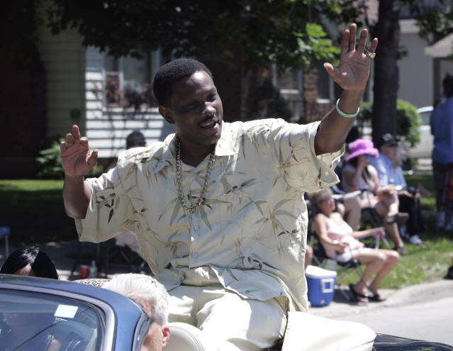 FILE - In this June 10, 2007, file photo, Pernell Whitaker waves to the crowd during a parade before he was inducted into the International Boxing Hall of Fame in Canastota, N.Y. Former boxing champion Pernell Whitaker has died after he was hit by a car in Virginia. He was 55. Police in Virginia Beach on Monday say Whitaker was a pedestrian when struck by the car Sunday night, July 14, 2019. The driver remained on the scene, where Whitaker was pronounced dead. (AP Photo/Mike Groll, File)