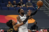 Brooklyn Nets forward Jeff Green (8) goes for a layup over Toronto Raptors forward Freddie Gillespie (55) during the first half of an NBA basketball game Tuesday, April 27, 2021, in Tampa, Fla. (AP Photo/Chris O'Meara)