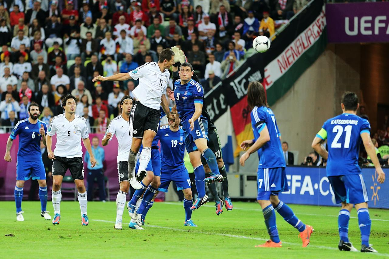 GDANSK, POLAND - JUNE 22:  Miroslav Klose of Germany scores their third goal during the UEFA EURO 2012 quarter final match between Germany and Greece at The Municipal Stadium on June 22, 2012 in Gdansk, Poland.  (Photo by Alex Grimm/Getty Images)