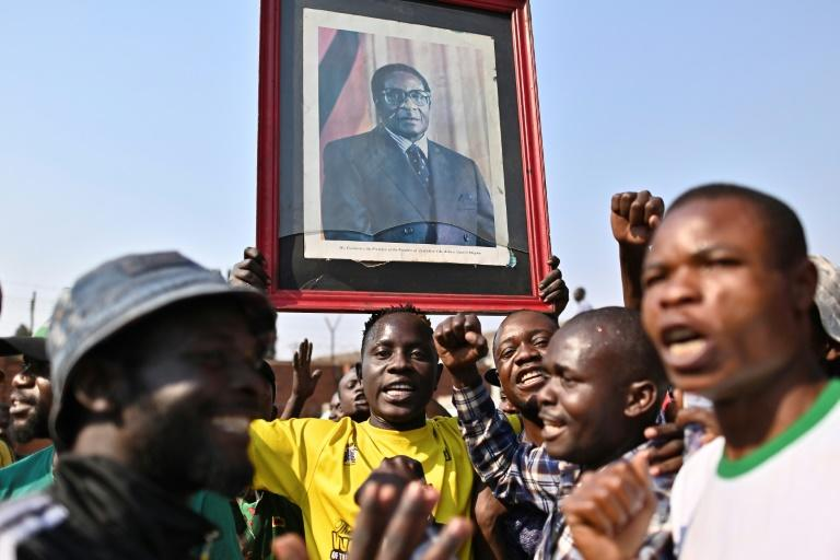 Many Zimbaweans will remember Mugabe more for the economic mismanagement and increasingly tyrannical rule that followed the initial hope oftheir liberation (AFP Photo/TONY KARUMBA)