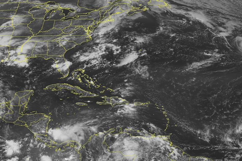 This NOAA satellite image taken Saturday, August 18, 2012 at 1:45 PM EDT shows clouds associated with a tropical wave of low pressure moving over Hispaniola. This system kicks up a few light showers, but no heavy rainfall.  To the north, the tail end of a front lingers over the Bahamas and Florida, creating shower and thunderstorm activity.  In the western Caribbean Sea, an area of low pressure produces moderate to heavy rains as it slowly advances westward into Costa Rica and Panama. (AP PHOTO/WEATHER UNDERGROUND)