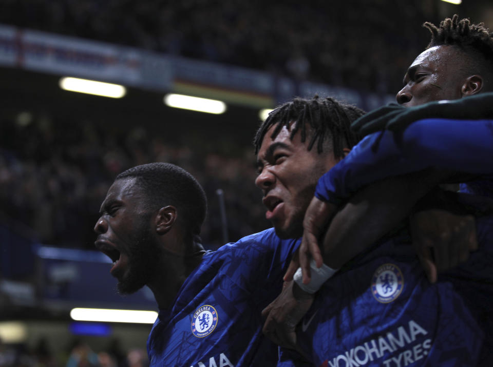 Chelsea's Reece James, center, celebrates with teammates after scoring his side's fourth goal during the Champions League, group H, soccer match between Chelsea and Ajax, at Stamford Bridge in London, Tuesday, Nov. 5, 2019. (AP Photo/Ian Walton)