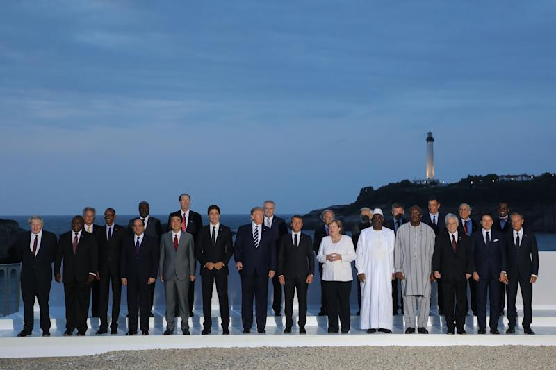 President Donald Trump poses with other G7 leaders and guests for a